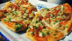 Porciones de Pizza de pollo y verduras